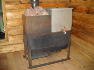 Установка металлической печи в баню: это сможет каждый